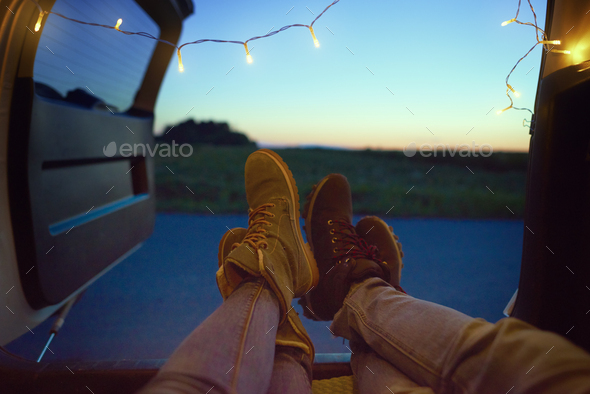 Close up of couple's legs in a car - Stock Photo - Images