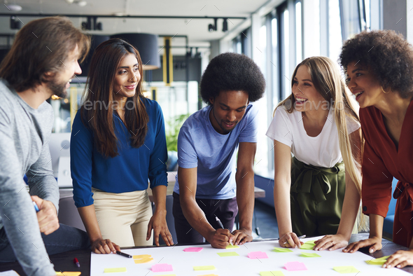 Multi ethnic group of business people sharing new ideas - Stock Photo - Images