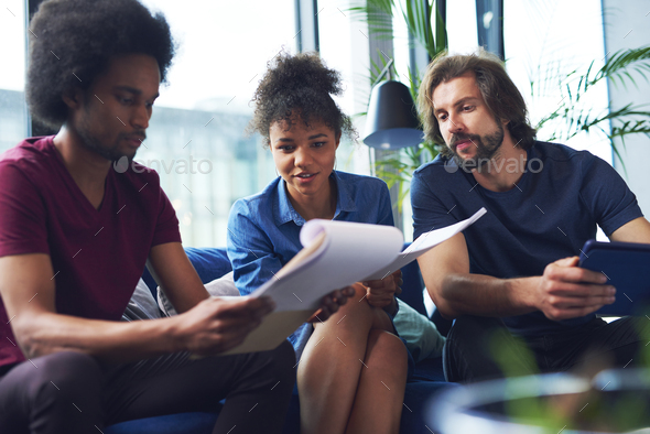 Mixed raced people working in the office - Stock Photo - Images