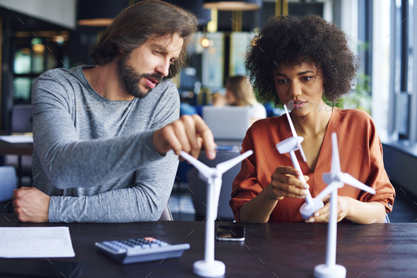 Focused business couple exchanging their ideas - Stock Photo - Images