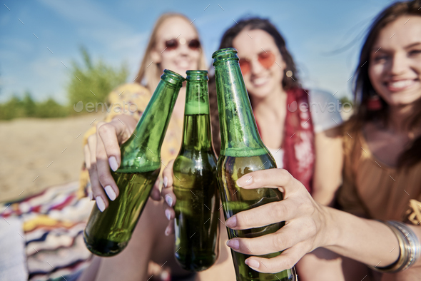 Making a toast on the beach - Stock Photo - Images