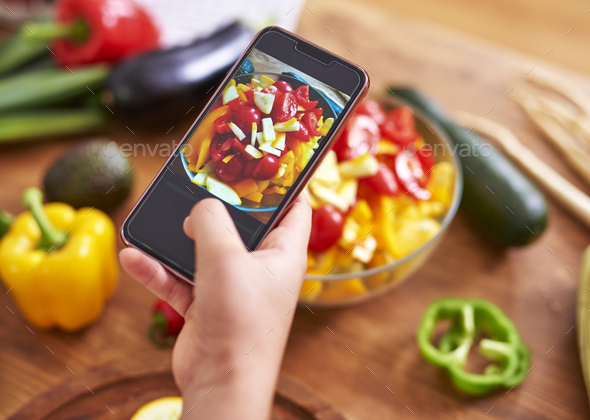 Taking picture of healthy salad - Stock Photo - Images