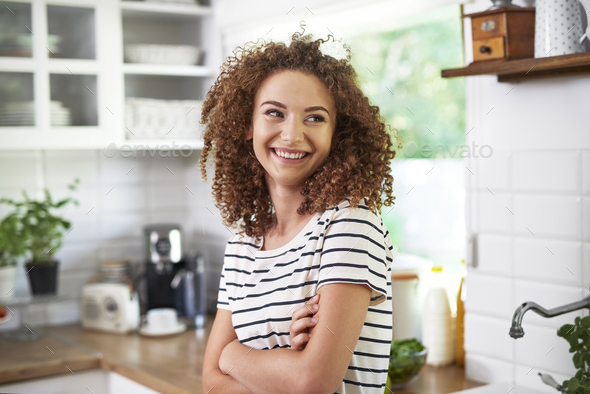 Young woman in her kitchen - Stock Photo - Images