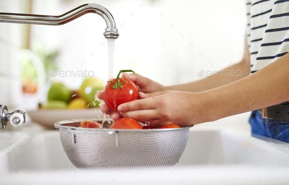 Colander full of freshly washed tomatoes - Stock Photo - Images