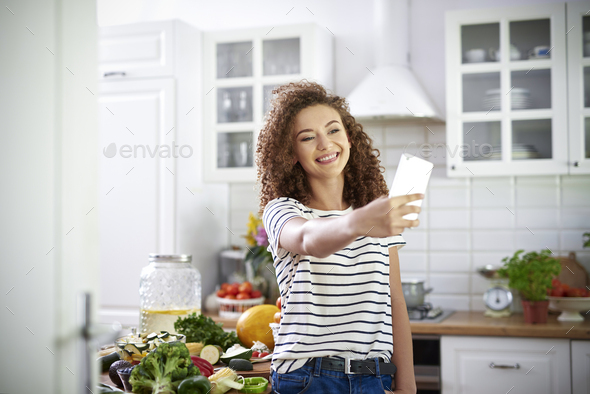Woman taking selfie in the kitchen - Stock Photo - Images