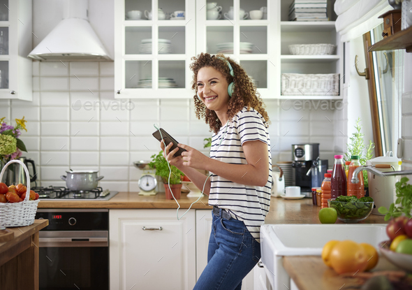 Woman turning on her favorite song - Stock Photo - Images
