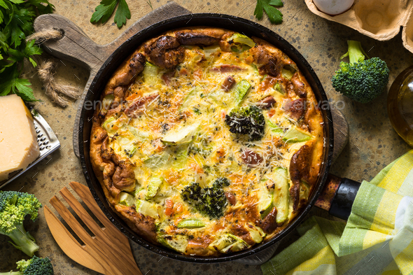 Frittata with sausage and vegetables in skillet - Stock Photo - Images