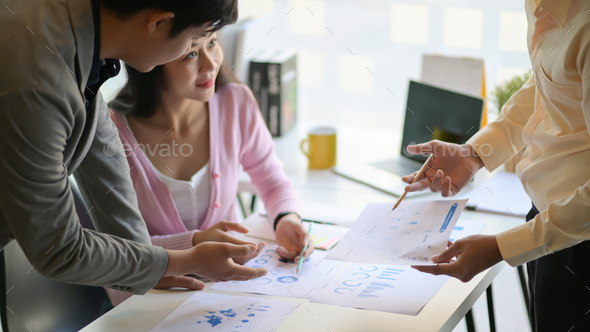 New generation of young business team is planning the next year in a modern office. - Stock Photo - Images