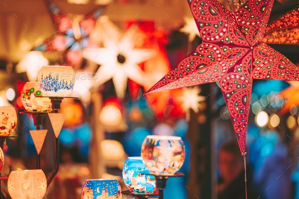 Close up of coloreful stars illuminated on Xmas tree at Christmas Market in Hamburg, Germany - Stock Photo - Images
