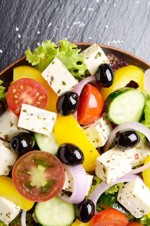 Top view at Mediterranean diet dish greek salad on slate tray - Stock Photo - Images
