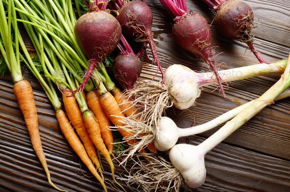 Vegetarian background of fresh organic beetroots - Stock Photo - Images