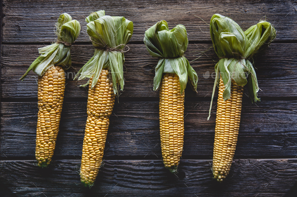 fresh corn on wooden table - Stock Photo - Images