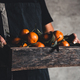 A box of tangerine in male hands on a gray background. Farmer, eco fruits, food. PNOV2019 - PhotoDune Item for Sale