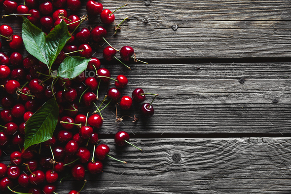 fresh cherries on wooden table, healthy food, fruit - Stock Photo - Images