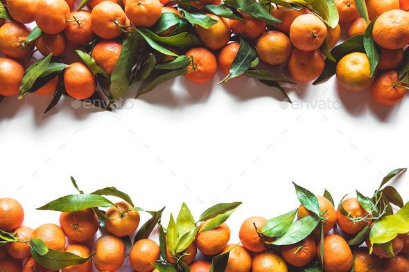 Oranges fruits composition with green leaves and slice on white wooden background, top view - Stock Photo - Images