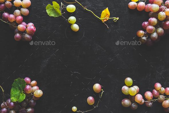 Dark Food - Fresh unpolished dark red black grapes on black slate stone background - Stock Photo - Images