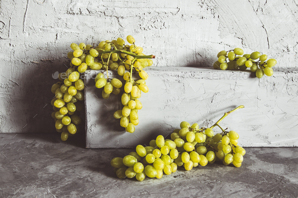 Grapes on grey kitchen table with copyspace - Stock Photo - Images