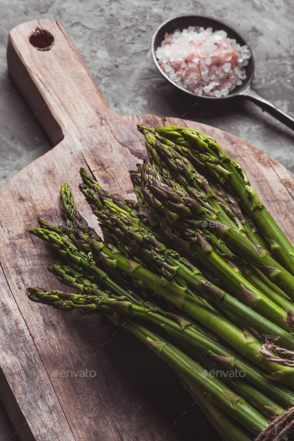 Asparagus on a cutting board. Healthy food, health on a concrete background - Stock Photo - Images