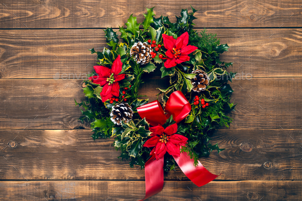Amazing Christmas wreath with big red bow on the streets of New York - Stock Photo - Images