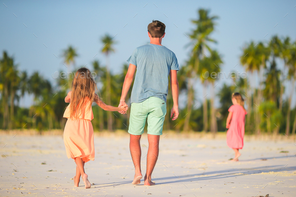 Happy father and his adorable little daughter at tropical beach. Caucasian family having fun - Stock Photo - Images