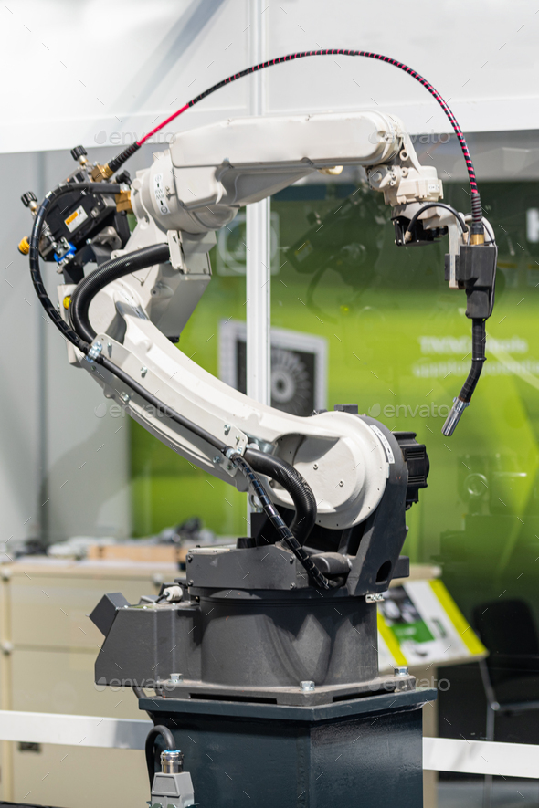 Robotic arm welding system in a manufacturing production plant - Stock Photo - Images