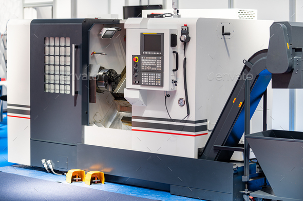 Automated CNC Machine in a Metal Processing Plant - Stock Photo - Images