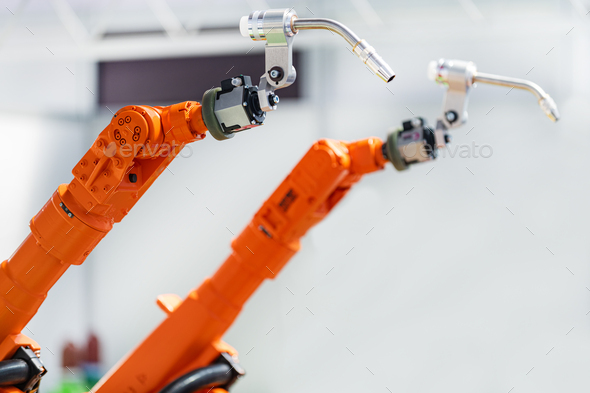 Dual robotic arms, welding system, new technology - Stock Photo - Images