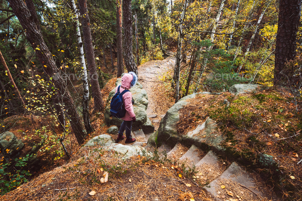 Adult women with backpack on hiking path trail in forest. Travel lifestyle adventure concept - Stock Photo - Images