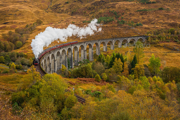 Old Fashioned Steam Train with Air Whistle on Glenfinnan Viaduct, Scotland in Autumn - Stock Photo - Images