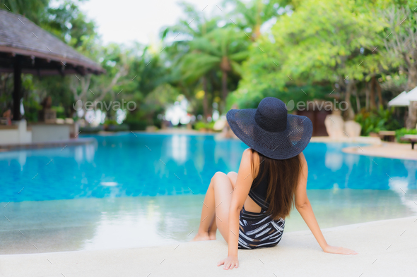 Portrait beautiful young asian women happy smile relax around swimming pool - Stock Photo - Images