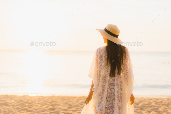 Portrait beautiful young asian women happy smile relax around beach sea ocean - Stock Photo - Images