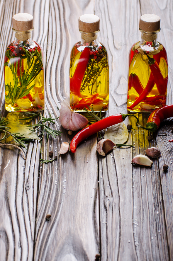 Food background made of oils condiments and spices on kitchen table. Cooking concept - Stock Photo - Images