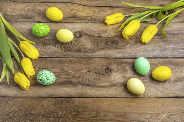 Easter yellow green eggs and tulips, copy space - Stock Photo - Images