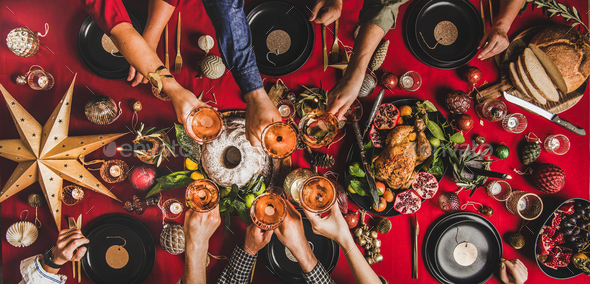 Flat-lay of family celebrating and clinking glasses at Christmas - Stock Photo - Images