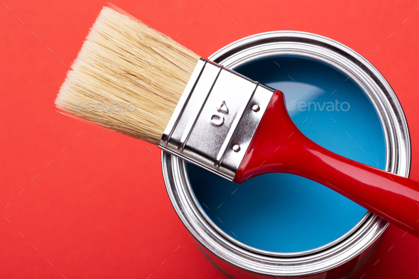 Close Up View on Can with Blue Paint and Brush. - Stock Photo - Images