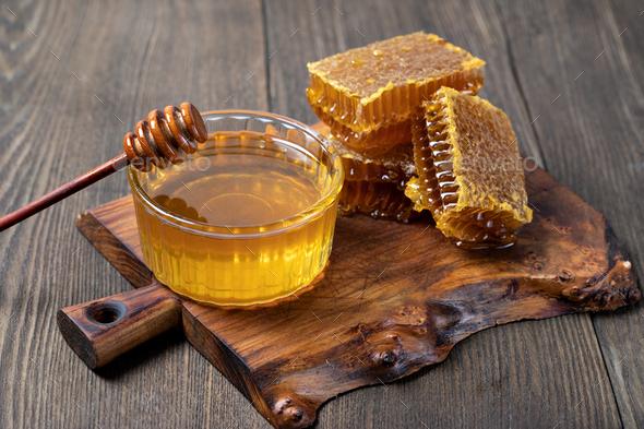 Honey and Honeycomb slice - Stock Photo - Images