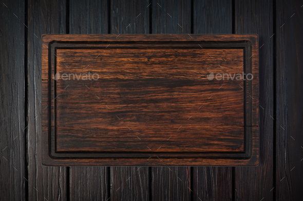 cutting board on a wooden table - Stock Photo - Images