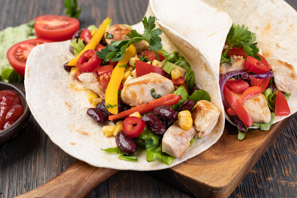 burrito with vegetables and tortilla - Stock Photo - Images