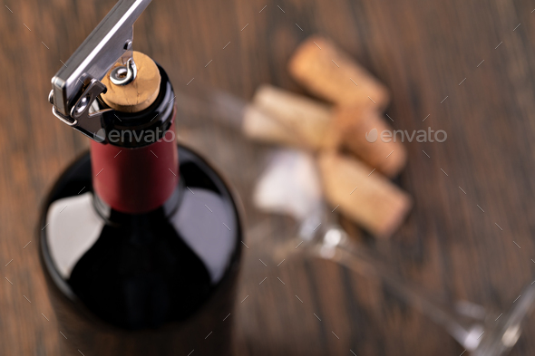 Corkscrew and bottle of wine - Stock Photo - Images