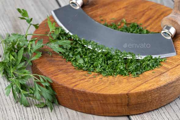 Chopping parsley - Stock Photo - Images