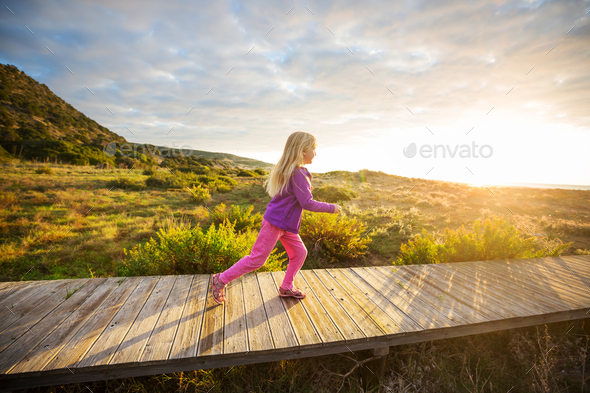 Girl on boardwalk - Stock Photo - Images