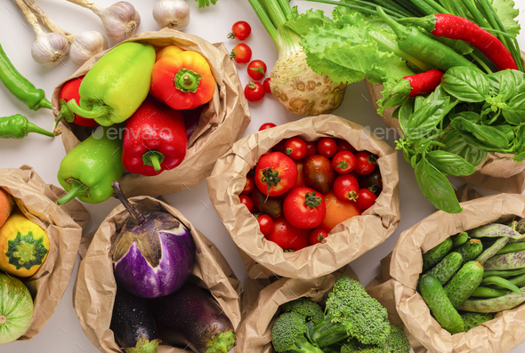 Assorted raw organic vegetables from garden in zero waste packages - Stock Photo - Images