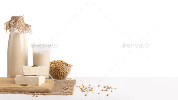 Soy milk, beans and tofu cheese on white background - Stock Photo - Images