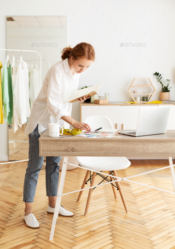 Fashion startup. Designer planning financials for own showroom - Stock Photo - Images