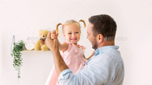 Portrait of daughter dancing with her dad - Stock Photo - Images