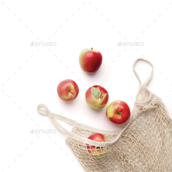Fresh red apples in zero waste net bag on white background - Stock Photo - Images