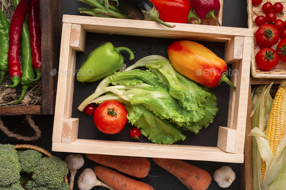 Fresh vegetables in eco wooden boxes on counter - Stock Photo - Images