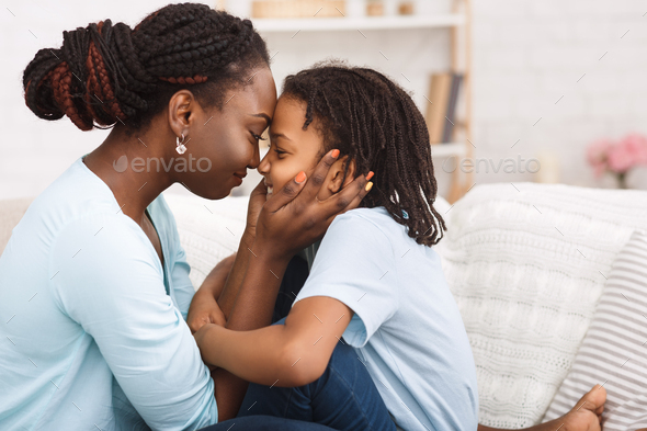 Loving african mom spending time with child - Stock Photo - Images
