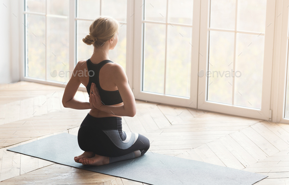 Reverse prayer pose perfomed by young woman - Stock Photo - Images