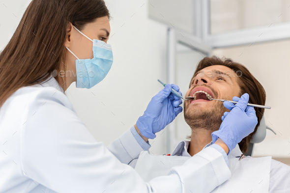 Man patient making check up in dental clinic - Stock Photo - Images